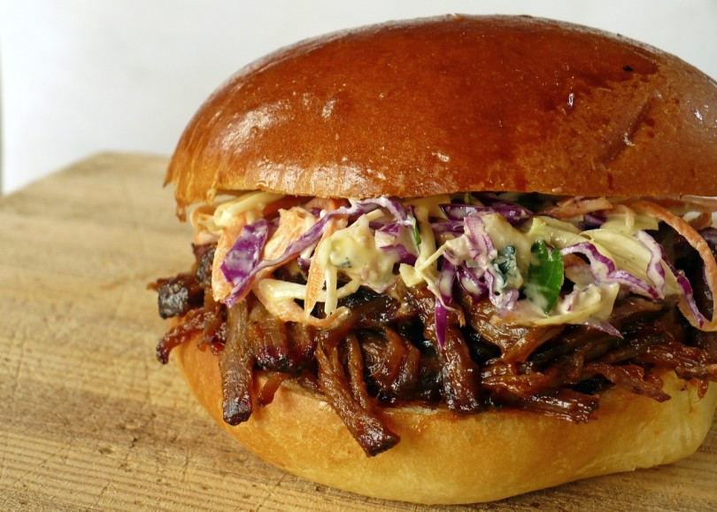 Mix beef with BBQ sauce and serve on a bun topped with cole slaw.